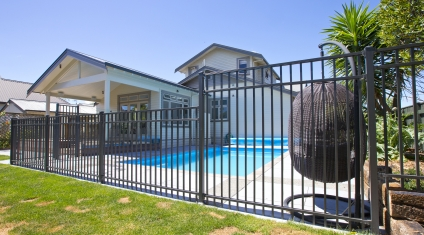Contemporary Pool Fencing with matching gate and JH Clamp frameless glass balustrade