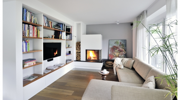 A Spartherm corner wood fire. Interior design by Jeanette Heerwagen, Germany.