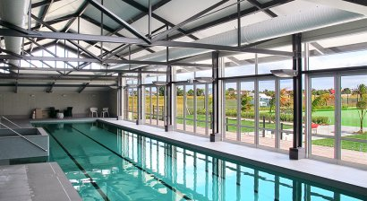 Energy-Efficient Heating and Condensation Control for Indoor Pool Pavilion