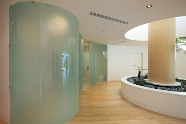 Curved Glass Sliding Doors for Jagged Edge Guest House