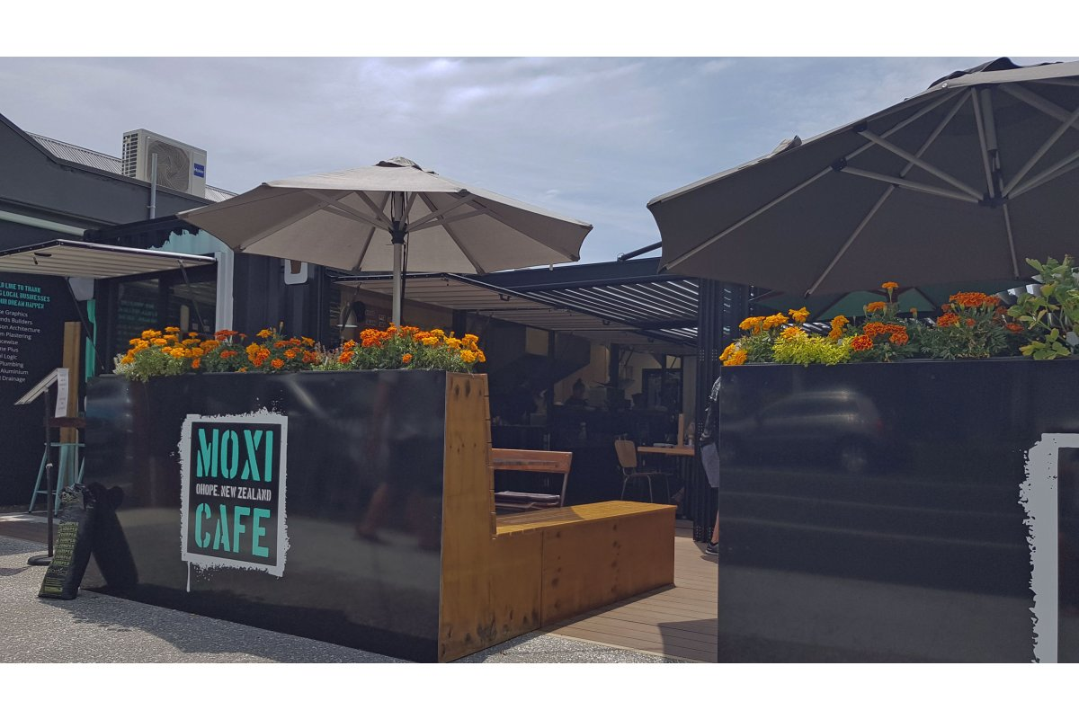 Moxi Cafe offers shelter under the stunning Bask louvre roofs in their courtyard.