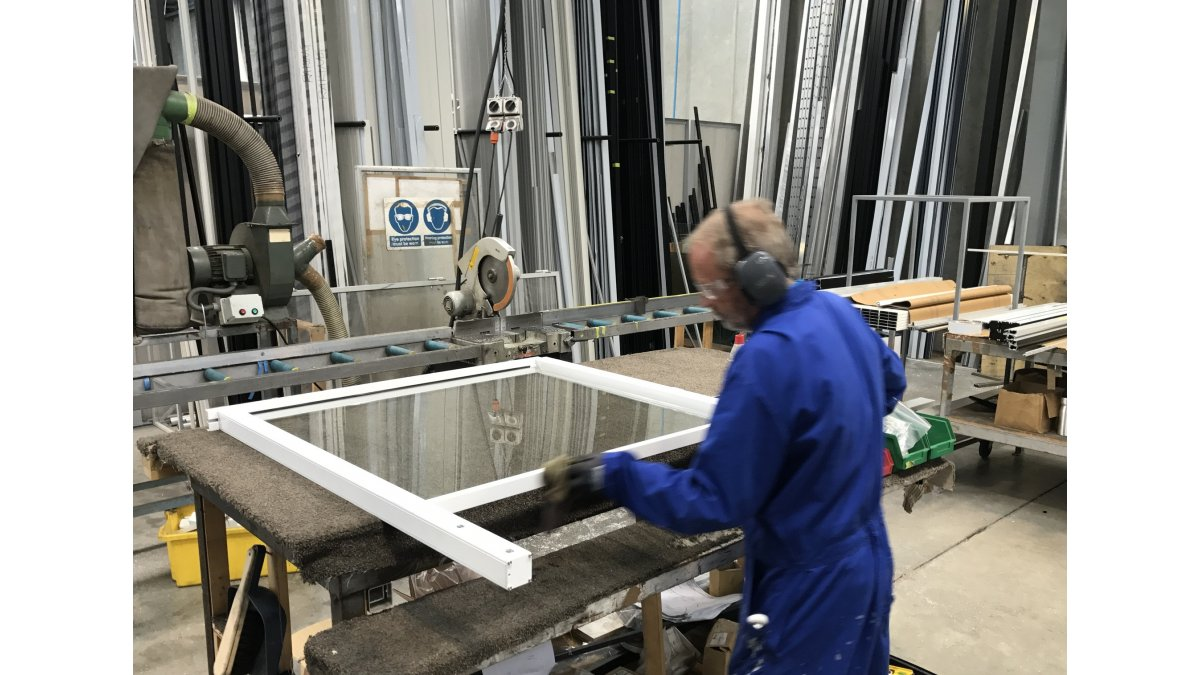 Factory glazing of Clearspan Vista panel.